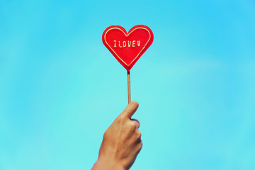 heart-lollipop on blurred background.Lovely valentine candy for lovers.