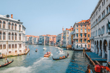Gondolas and motor boats with tourists traveling the Grand Canal in Venice, Italy