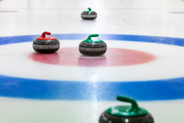 curling stones on the ice