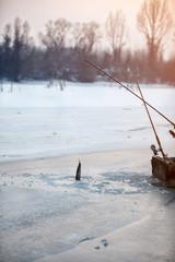 Ice fishing - Raw fish, winter fishing, frozen lake