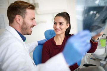 Girl with dentist in clinic take care of her teeth