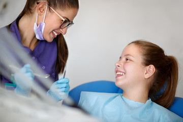 Smiling patient with dentist starting checkup