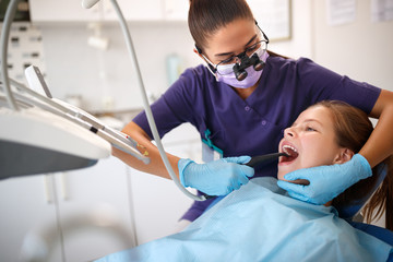 Dentist repair girls' teeth