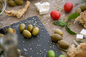 top view antioxidant green olives in black plate.