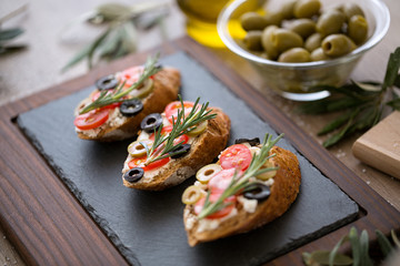Tasty fresh bruschetta with vegetables.