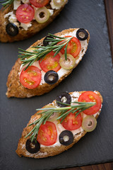 top view of traditional tasty fresh bruschetta with fresh vegetables.