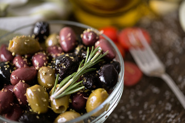 mix of olives in oil with spices.