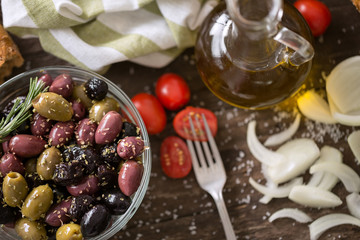 Mediterranean mix of olives for salad in oil .