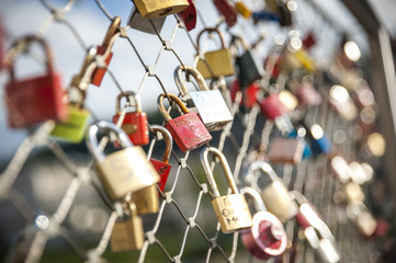 as a promise of love, the lovers close padlocks along the bridges