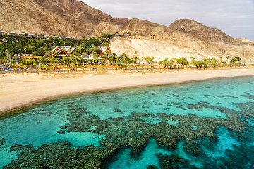 Coral reef of Red Sea, beach and desert near Eilat, Israel