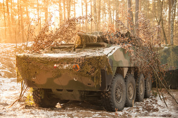 Military vehicle in a winter forest