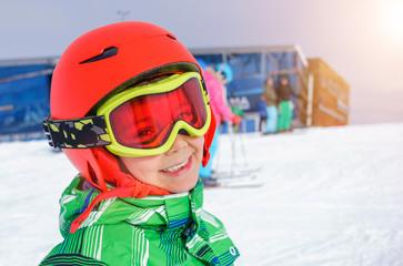 Skier boy in a winter ski resort.