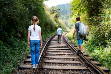 Family walking along train tracks