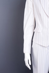 Female mannequin in white striped suit. Women white color waistcoat and trousers, copy space. Ladies outfit boutique.