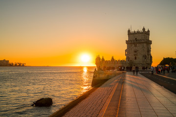 Lisbon, Portugal at Belem Tower on the Tagus River during amazing sunset view.