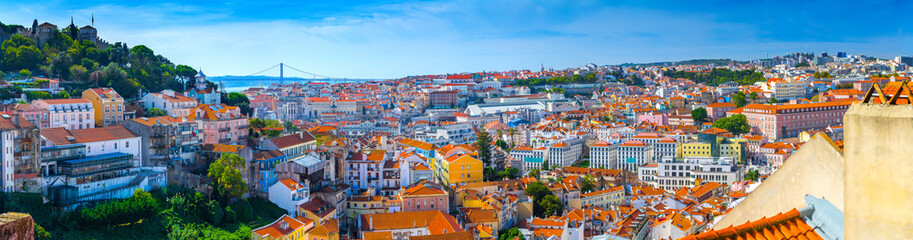 Summertime sunshine day cityscape panoramic view of town, Sao Jorge Castle, and all historic old centre in Lisbon, Portugal. Wall mural