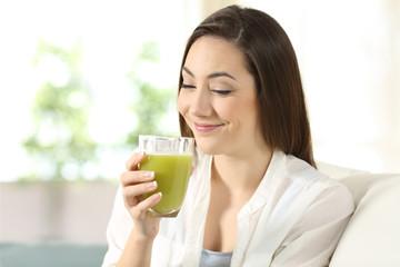 Woman tasting a good vegetable juice