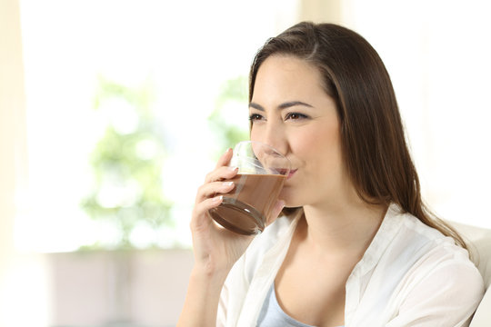 Woman drinking a cocoa shake