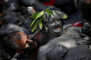 "Members of the ""Bloco Pretinhos do Mangue"" (Block of Blackheads from Mud) group perform during carnival festivities in Curuca"
