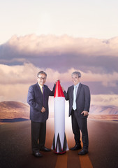 couples of asian business man with rocket missile standing on countryside highway ,conceptual for business strategy target