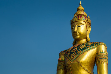 Golden image of buddha thai style on blue sky background