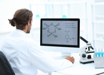 research scientist using computer chemistry laboratory