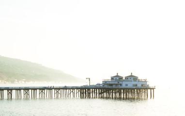 pier in Malibu, California with early morning fog