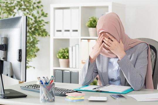professional female muslim worker having problem
