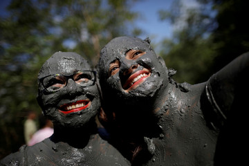 """Members of the """"Bloco Pretinhos do Mangue"""" (Block of Blackheads from Mud) group perform during carnival festivities in Curuca"""