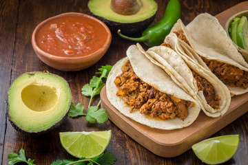 Mexican vegan soy tacos with lime salsa and avocado