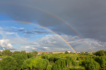 Fototapete - Beautiful double rainbow over summer city