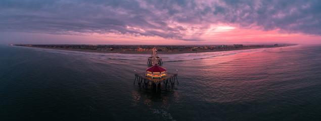 Aerial view of Huntington Beach Pier in Huntington Beach, California at sunrise