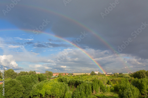 Fotomurales Beautiful double rainbow over summer city