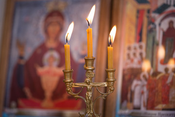 candle against the background of orthodox icons