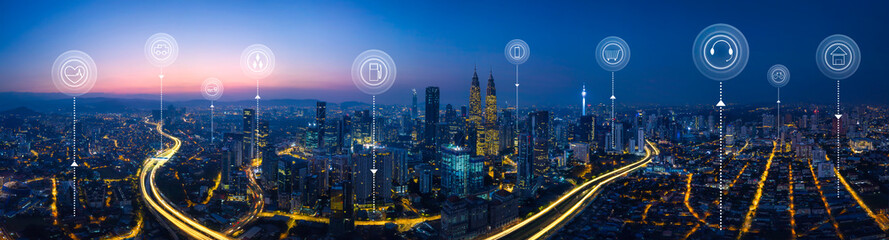 Panorama aerial view in the  cityscape skyline  with smart services and icons, internet of things, networks and augmented reality concept , early morning sunrise scene . Wall mural