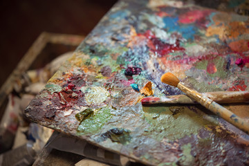 colored oil paints and brushes on the artist's palette