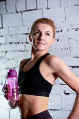 Female athletes holding bottle of water. Close-up portrait sportsgirl photos. Concept sporty lifestyle.