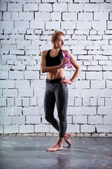 Young woman fitness workout. Photo set of sporty female blond girl wearing sports clothes. Female athletes holding bottle of water.