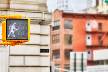 Close up picture of a walk pedestrian traffic signal, selective focus, New York City, USA.