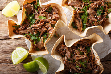 Mexican barbacoa tacos with spicy pulled beef close-up. horizontal top view