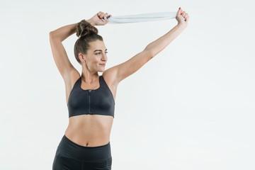 Portrait of positive caucasian female athlete in good fit.