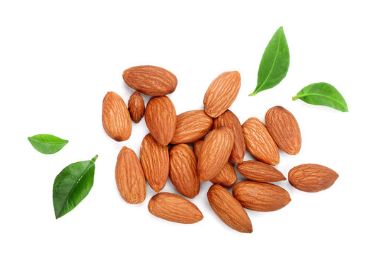 almonds with leaves isolated on white background. Top view. Flat lay