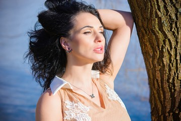 Tender spring casual romantic look of stylish women, pretty jewelry. Outdoor atmospheric lifestyle photo of beautiful lady. Warm spring