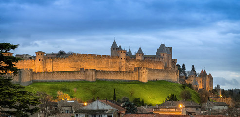 Panorama of Carcassonne medieval fortified town at dusk, Aude, France