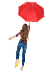 back view of girl holding red umbrella isolated on white