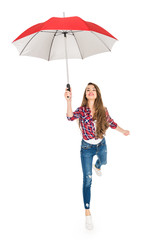 happy young woman holding red umbrella isolated on white