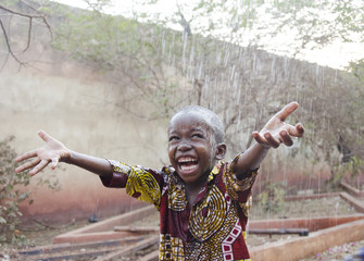 Sweet little African boy under the rain in Mali (Africa)