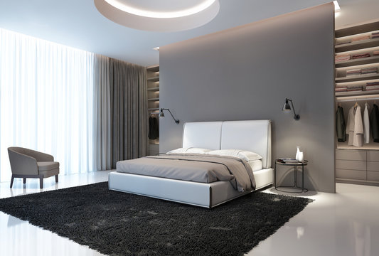 Modern grey and white bedroom with walk in closet