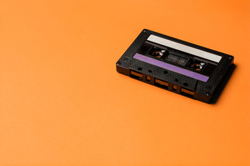 Retro cassette tape over orange background. top view. copy space