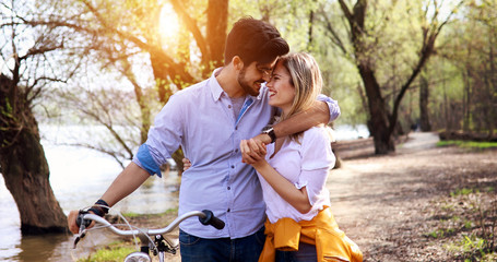Couple in love riding bicycle in city and dating